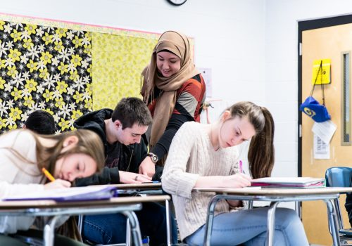 Teacher working with high school students